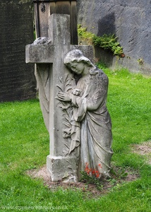 Grieving Woman and Cross